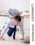extremely busy employee working ...   Shutterstock . vector #1203998977
