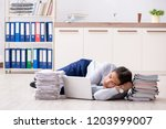 extremely busy employee working ...   Shutterstock . vector #1203999007