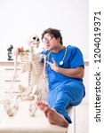 funny doctor with skeleton in...   Shutterstock . vector #1204019371