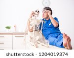 funny doctor with skeleton in...   Shutterstock . vector #1204019374