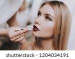 blond girl in beauty salon.... | Shutterstock . vector #1204034191