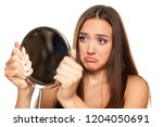 young unhappy woman looking her ... | Shutterstock . vector #1204050691
