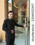 asian man in elegant black suit ...   Shutterstock . vector #1204052347