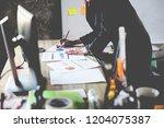 close up business woman hand... | Shutterstock . vector #1204075387