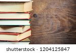 stack of books on old wood... | Shutterstock . vector #1204125847