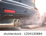 close up of smoky dual exhaust... | Shutterstock . vector #1204130884