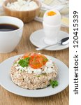 bread with cottage cheese, cherry tomatoes, boiled egg and coffee - stock photo