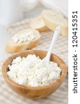 bowl of cottage cheese and slices of baguette in the background - stock photo