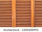 brown wooden shutters close up  ... | Shutterstock . vector #1204200991