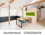 open bright kitchen with black...   Shutterstock . vector #1204206634