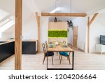 wooden table in modern dining...   Shutterstock . vector #1204206664