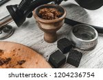 hookah bowl with tabacco leaf... | Shutterstock . vector #1204236754