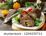 stuffed beef roll with pear and ... | Shutterstock . vector #1204255711