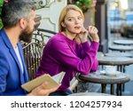 girl interested what he reading....   Shutterstock . vector #1204257934