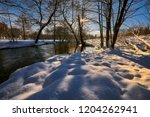 small river in a winter rural... | Shutterstock . vector #1204262941