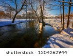 small river in a winter rural... | Shutterstock . vector #1204262944