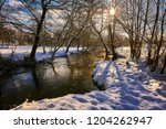 small river in a winter rural... | Shutterstock . vector #1204262947