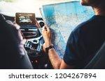 tourist traveler driving and... | Shutterstock . vector #1204267894