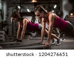 sporty women doing endurance... | Shutterstock . vector #1204276651