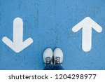white shoes standing on blue... | Shutterstock . vector #1204298977