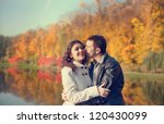 young couple in autumn park | Shutterstock . vector #120430099