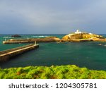view of the seaport of tapia de ... | Shutterstock . vector #1204305781