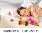 masseur doing massage on woman... | Shutterstock . vector #1204320844