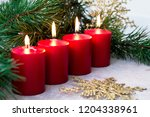 four red burning advent candles ... | Shutterstock . vector #1204338961