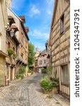 alley with half timbered houses ... | Shutterstock . vector #1204347391
