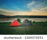 tourist camping tent near the... | Shutterstock . vector #1204373551