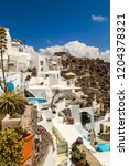 skyline of oia  traditional...   Shutterstock . vector #1204378321