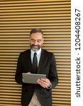 handsome middle age businessman ... | Shutterstock . vector #1204408267