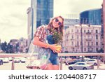 shopaholic with plant. beaming... | Shutterstock . vector #1204408717