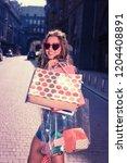 cheerful shopaholic. cheerful... | Shutterstock . vector #1204408891