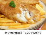 Battered cod with fries. - stock photo