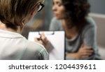 sad lady telling... | Shutterstock . vector #1204439611