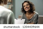 young happy lady talking with... | Shutterstock . vector #1204439644