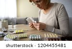sick elderly lady sitting at... | Shutterstock . vector #1204455481
