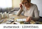 retired female in glasses... | Shutterstock . vector #1204455661