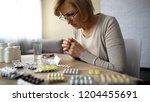woman reading prescription ... | Shutterstock . vector #1204455691