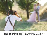 wedding photographer takes... | Shutterstock . vector #1204482757