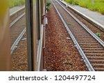 railway seen from the window of ... | Shutterstock . vector #1204497724