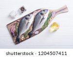 raw dorado fish and ingridient... | Shutterstock . vector #1204507411