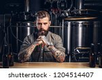 portrait of a pensive tattooed... | Shutterstock . vector #1204514407