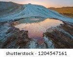 crater of mud volcano. sunset...   Shutterstock . vector #1204547161