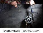 men's hands with fishing tackle ...   Shutterstock . vector #1204570624