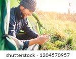 bearded traveler man portrait... | Shutterstock . vector #1204570957