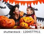 mother and daughter having fun... | Shutterstock . vector #1204577911