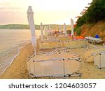 umbrellas and sunbeds on the... | Shutterstock . vector #1204603057