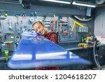 mechanic woman repairing a...   Shutterstock . vector #1204618207